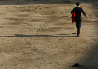 Spanish bullfighter Barrera walks away before a bullfight at Plaza de Acho bullring in Lima