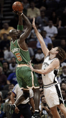 Spurs Obertodefends against  Celtics Garnett during the first half of their NBA basketball game in San Antonio