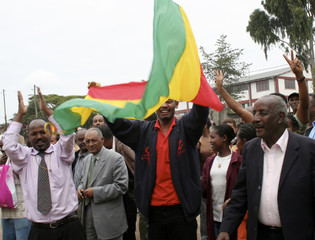 Relatives of Ethiopian opposition members freed from jail celebrate outside Kaliti prison in Addis Ababa