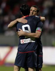 Atletico Madrid's striker Luis Garcia celebrates with team mate afte scoring against Toluca during their friendly soccer match at Nemesio Diez stadium in Toluca City