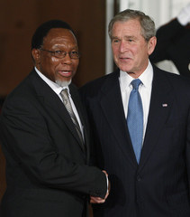 U.S. President Bush greets South Africa's President Motlanthe upon arrival at White House in Washington