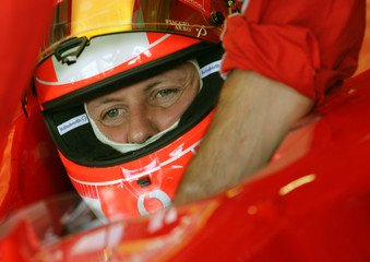 Ferrari's world champion Schumacher of Germany prepares to leave the pit for his qualifying session ...