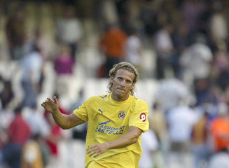 Villarreal's Forlan celebrates after winning their Spanish First Division soccer match in Valencia