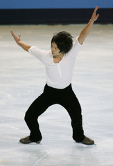 Chinese skater Song Gao practises his free skating programme during a training session before the Bompard Trophy event at Bercy in Paris