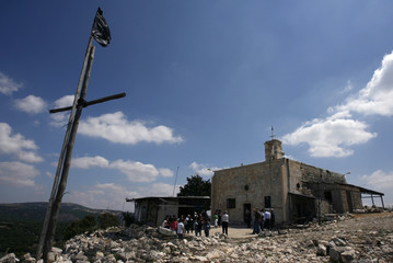 Arabs stand outside a church in Iqrit