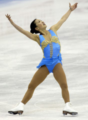 MICHELLE KWAN PERFORMS HER QUALIFYING SKATE AT WORLD CHAMPIONSHIPS.