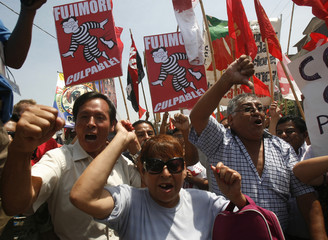 People celebrate the conviction of former Peruvian President Fujimori in Lima