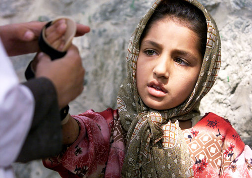 AN AFGHAN GIRL IS FITTED WITH A BRACE IN A KABUL HOSPITAL.