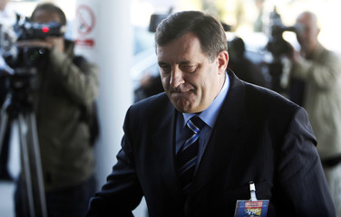 Milorad Dodik, PM of Bosnia's Serb Republic, arrives for a meeting between Bosnia's top officials and foreign diplomats in Butmir
