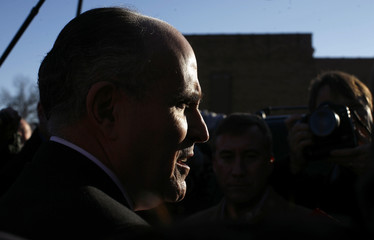 U.S. Republican presidential candidate and former New York City Mayor Rudy Giuliani leaves a campaign stop in Indianola, Iowa