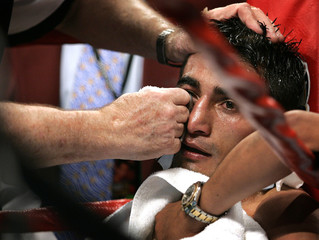 Erik Morales is attended to by his corner during fight with Marco Antonio Barrera.