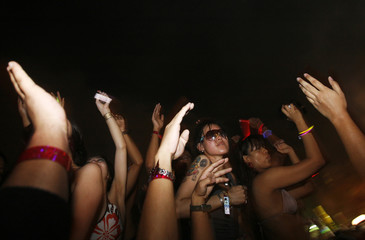 Revellers dance during the annual Zoukout dance party on Singapore's Sentosa Island