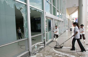 Thai workers clean up the scene of a bomb blast at a shopping mall in Songkhla province.