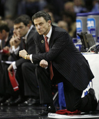 Louisville Cardinals head coach Pitino watches his team against North Carolina Tar Heels in their NCAA East Regional championship basketball game in Charlotte