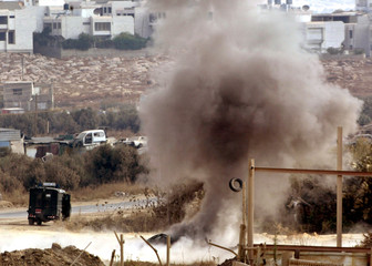 SMOKE RISES FROM A CAR BLOWN UP BY ISRAELI ARMY NEAR THE WEST BANK CITYOF NABLUS.