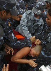 Police detain a nun outside the Chinese Embassy Visa Section in Kathmandu