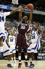 Memphis' Chris Douglas-Roberts blocks the shot by Texas A&M's Joseph Jones in their NCAA men's South Regional semi-final basketball game in San Antonio