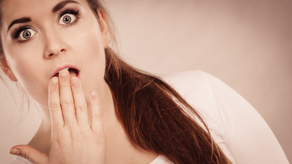 Shocked amazed woman covering mouth with hands
