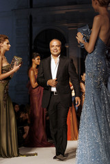 Lebanese designer Abed Mahfouz acknowledges applause at the end of haute couture fall/winter 2008 show during Rome Fashion Week