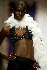 A Kenyan model displays a creation by local fashion designer Carol Mukene in Nairobi July 18, 2004 d..