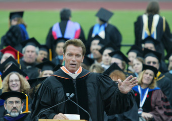 California Governor Schwarzenegger addresses graduates at Santa Monica College Commencement amid ...