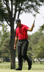 Tiger Woods reacts after making an eagle on the second hole during the final round of the WGC Bridgestone Invitational golf tournament in Akron