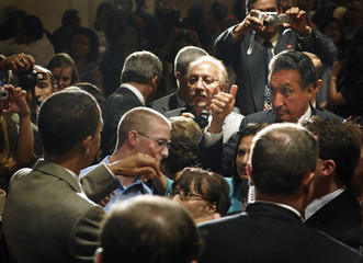 Cisneros gives a thumbs-up to Senator Obama after his remarks at a NALEO conference in Washington
