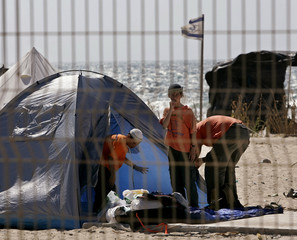 A recently-arrived group of settlers clean up a tent at a beach in Gush Katif, Gaza Strip.
