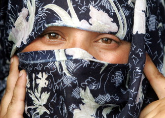 Pakistani Farhat Bibi, wife of Shehzad Ahmed, speaks to Reuters at her home in Osman Town in the cen..