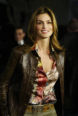 """Super model Cindy Crawford poses for photographs after arriving to the premiere of """"Confessions of a.."""