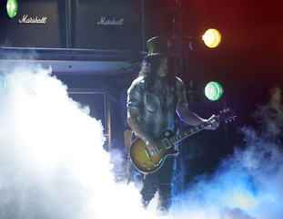 Slash appears onstage during Microsoft Chairman Gates' keynote address for the Consumer Electronics Show in Las Vegas