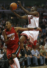 Chicago Bulls Luol Deng of Britain shoots on Miami Heats James Posey in Chicago