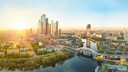 Tuinposter Moskou Sunrise over Moscow City district and Moscow river