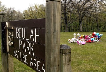 A memorial for two girls murdered sits in a nature area.