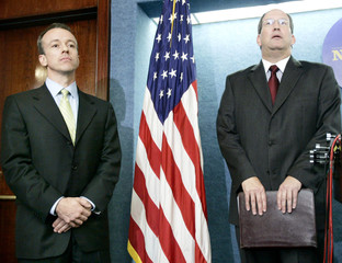 Republicans Colyandro and Ellis listen to questions during a news conference in Washington