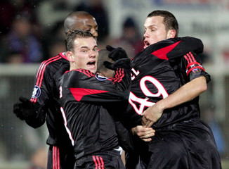 Ajax Amsterdam's players celebrate goal during a UEFA Cup match in Auxerre.