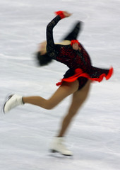 RUSSIA'S IRINA SLUTSKAYA SPINS DURING THE WOMEN'S FREE SKATING PROGRAM AT WORLD CHAMPIONSHIPS.