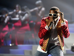 Kanye West of the US performs on stage at the Brit Awards at the Earls Court Arena in central London