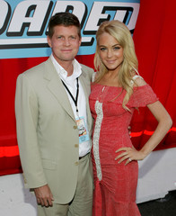 Actress Lindsay Lohan and producer Robert Simonds pose at the world premiere of Herbie Fully Loaded ...