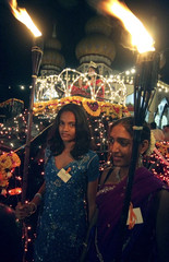 Surinamese Hindu devotees participate in a night march on the eve of Divali, or the Hindu Festival of Lights, in Paramaribo