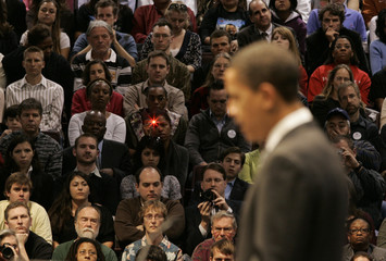 The crowd listens as democratic presidential candidate Senator Obama (D-IL) speaks at a rally in Austin
