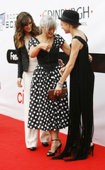 Sharman Macdonald, the writer of the new film 'The Edge of Love', helps fix the dress of actress Sienna Miller as her daughter, actress Keira Knightley looks on in Edinburgh