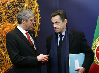 Portugal's PM Socrates talks with France's President Sarkozy at the start of a European Union Heads of State and Government summit in Brussels