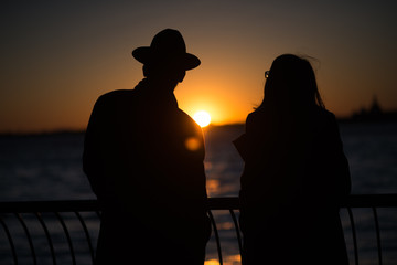 Two People contemplate the sunset
