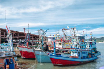 Wood fishing boats moored at wharf