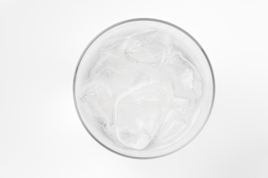 glass of soda with ice blocks isolated on white background, top view