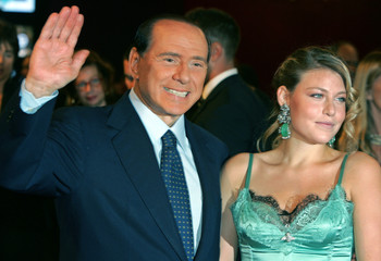 Italian Prime Minister Berlusconi and daughter Barbara arrive for Dolce & Gabbana's 20th anniversary party in Milan