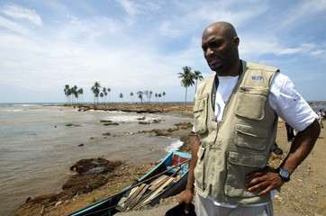 New York Giants wide receiver Amani Toomer surveys tsunami damage in Lam No in Aceh province.