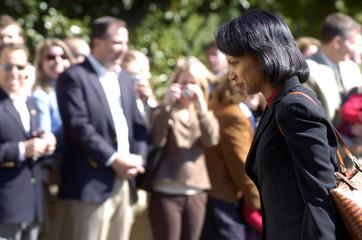 U.S. Secretary of State Condoleezza Rice walks past White House guests in Washington