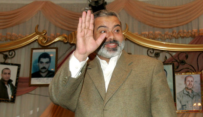 Hamas leader Ismail Haniyeh waves during his meeting with families of Palestinian prisoners in the Israeli jails in Gaza